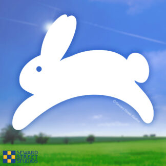 Seward Street Studios Leaping Bunny Vinyl Decal. Shown on a field background.
