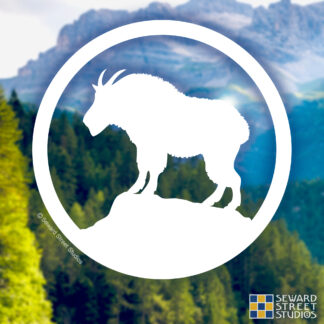 826 Seward Street Studios Mountain Goat Vinyl Decal. Shown on a mountain background