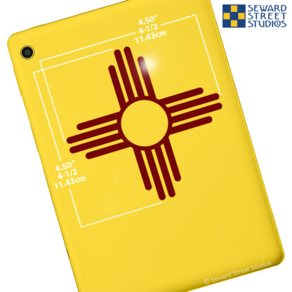 924 Seward Street Studios Zia Sun Symbol Vinyl Decal. Shown on a yellow tablet with dimensions