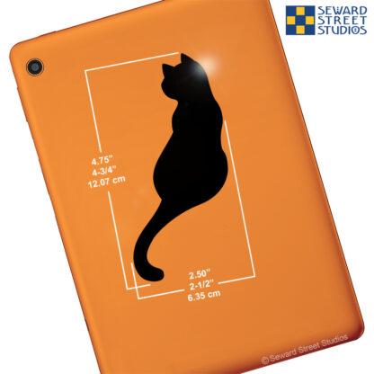 044 Seward Street Studios Sitting Cat Vinyl Decal. Shown on an orange tablet