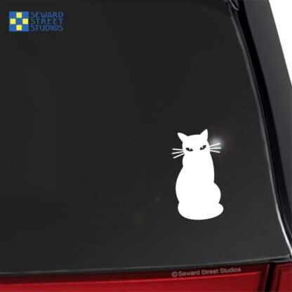 Seward Street Studios Cat Silhouette Vinyl Decal. Shown on a red car