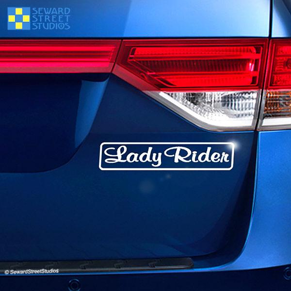 Seward Street Studios Lady Rider Vinyl Decal. Shown on a blue laptop