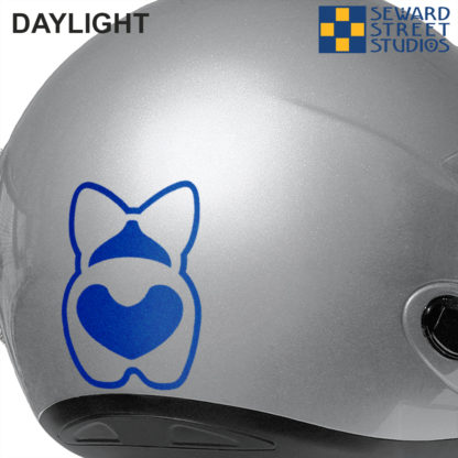 Blue Reflective Corgi Butt Decal Shown on a silver helmet in daylight