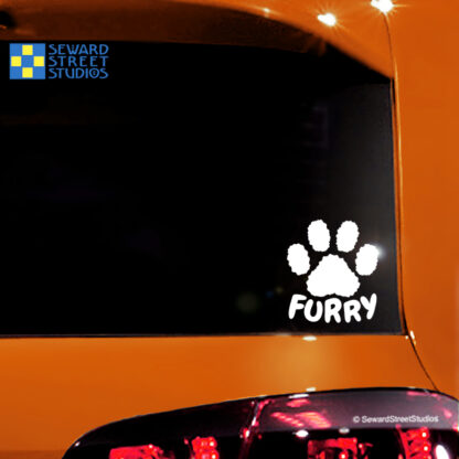Seward Street Studios Furry Paw Print Vinyl Decal. Shown on an orange car.