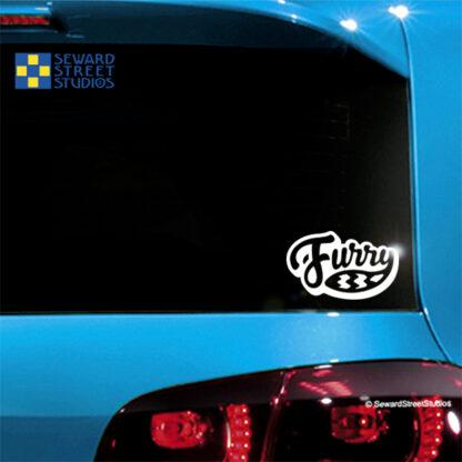 Seward Street Studios Raccoon Tail Furry Vinyl Decal. Shown on a blue car.