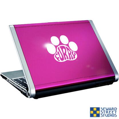 Seward Street Studios Furry Paw Print Vinyl Decal. Shown on a pink laptop.