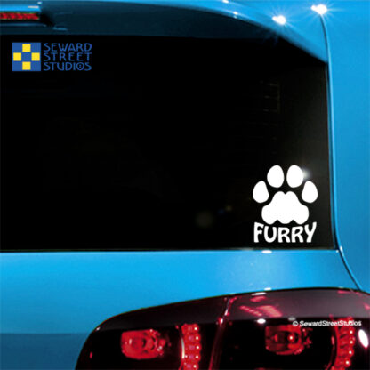 Seward Street Studios Furry Paw Print Vinyl Decal. Shown on a Blue car