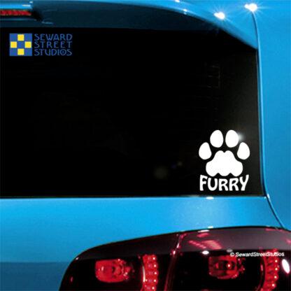 Seward Street Studios Furry Paw Print Vinyl Decal. Shown on a Blue car