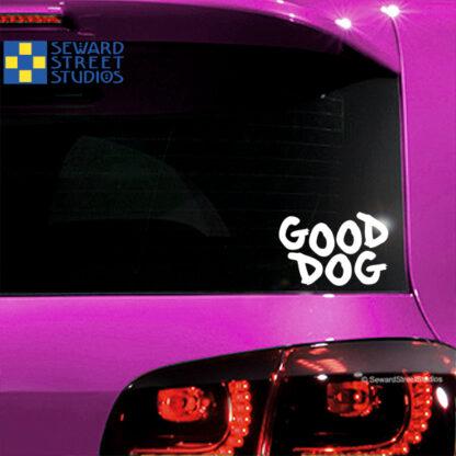 Seward Street Studios Good Dog Vinyl Decal. Shown on a pink car