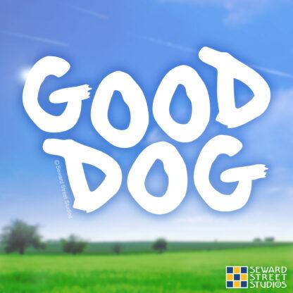 Seward Street Studios Good Dog Vinyl Decal. Shown on a field background