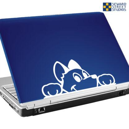 Seward Street Studios Peekaboo Dog Vinyl Decal. Shown on a blue laptop