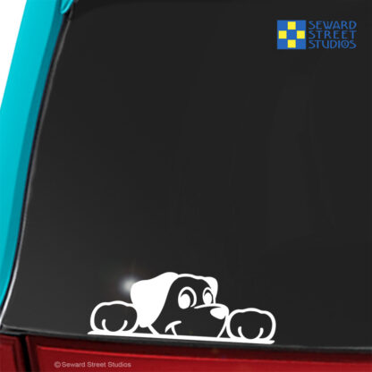 Seward Street Studios Peekaboo Dog Vinyl Decal. Shown on a blue car