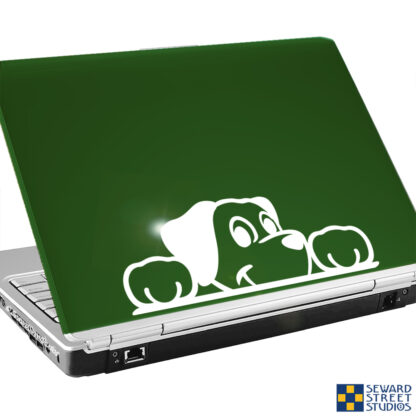 Seward Street Studios Peekaboo Dog Vinyl Decal. Shown on a green laptop