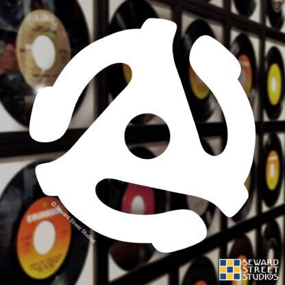 Seward Street Studios 45 adapter insert Vinyl Decal. Shown on a records background