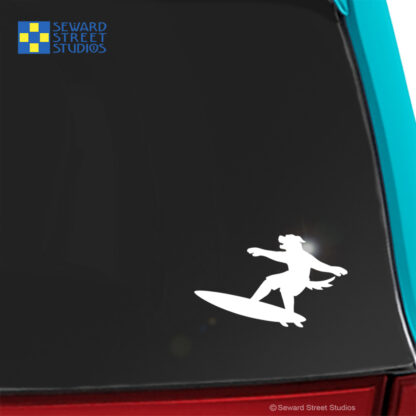 Seward Street Studios Surfboard Mascot Dog Decal. Shown on a teal car