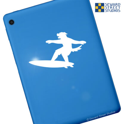 Seward Street Studios Surfboard Mascot Dog Decal. Shown on a blue tablet