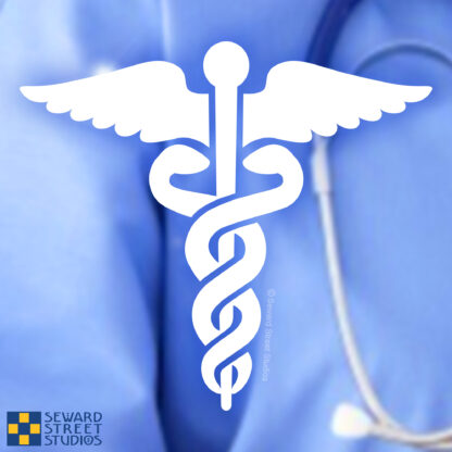 Seward Street Studios Nursing Caduceus Vinyl Decal. Shown on a scrubs background