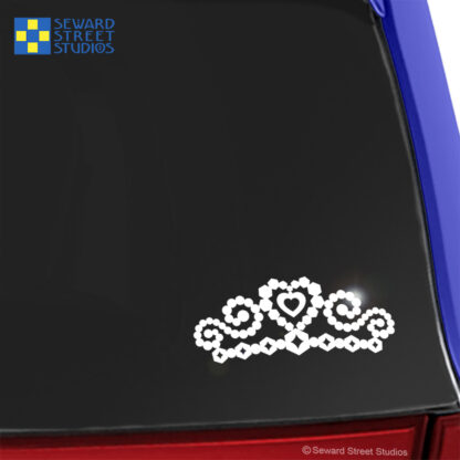 Seward Street Studios Tiara Vinyl Decal. Shown on a blue car