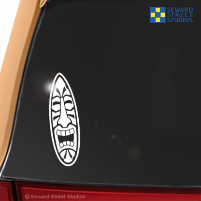 Seward Street Studios Surfboard Tiki Head Vinyl Decal. Shown on an orange car