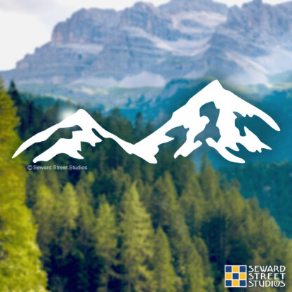 Seward Street Studios Mountains Vinyl Decal. Shown on a mountain background
