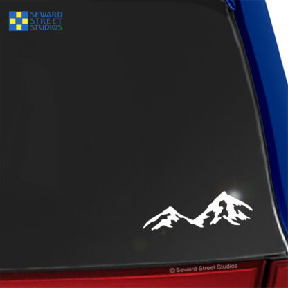 Seward Street Studios Mountains Vinyl Decal. Shown on a blue car