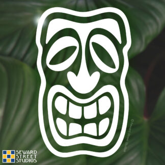 Seward Street Studios Tiki Head Vinyl Decal. Shown on a leaves background