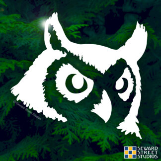 Seward Street Studios Owl Head Vinyl Decal. Shown on a trees background.