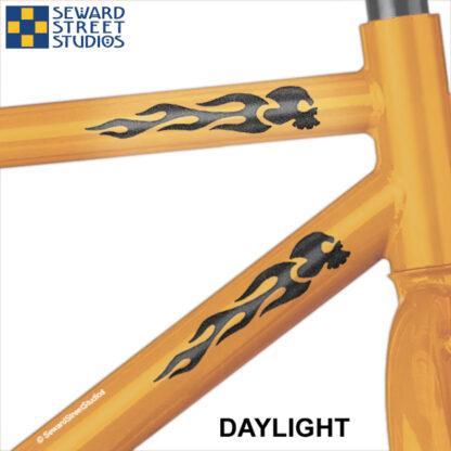 1137 Black Hyper Reflective Flame Skulls Decal Set by Seward Street Studios. Shown on an orange bike.