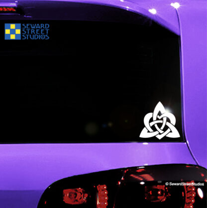 1157 White Heart Triquetra Vinyl Decal by Seward Street Studios. Shown on a pink car