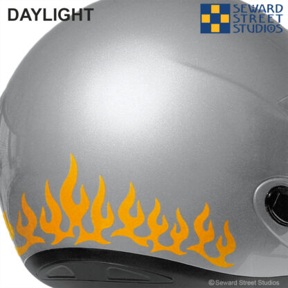 1207 Orange Hyper Reflective Flames Decal Set by Seward Street Studios shown on a silver helmet.