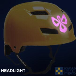 504 Seward Street Studios celtic knotwork angel reflective decal shown on a yellow helmet at night under headlights