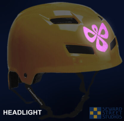 504 Seward Street Studios celtic knotwork angel reflective decal shown on a yellow helmet at night under headlights