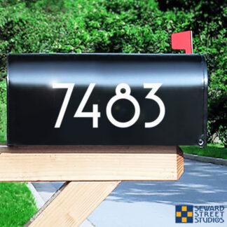 1229 Seward Street Studios Reflective Address Numbers, shown in white vinyl, on a black mailbox