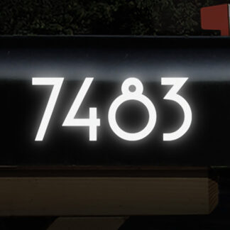 1229 Seward Street Studios Reflective Address Numbers, shown in white vinyl, at night on a black mailbox