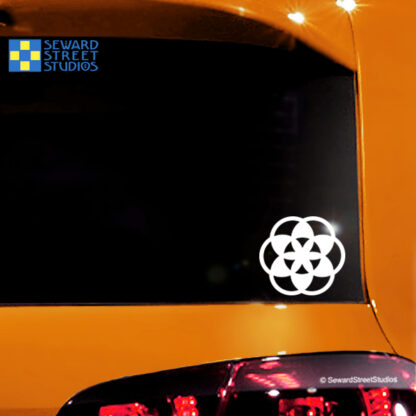 1167 Flower of Life Vinyl Decal by Seward Street Studios shown in white vinyl on an orange car