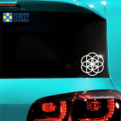 1165 Seed of Life Vinyl Decal by Seward Street Studios shown in white vinyl on a blue car