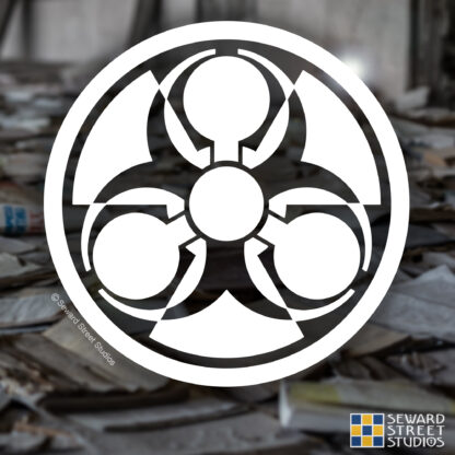 924 Seward Street Studios Weapons of Mass Destruction Symbol Vinyl Decal. Shown on a books background