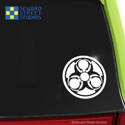 924 Seward Street Studios Weapons of Mass Destruction Symbol Vinyl Decal. Shown on a green car