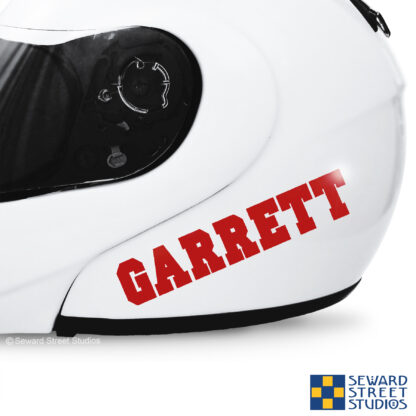 1230 Seward Street Studios Custom Name Vinyl Decal. Shown on a white helmet