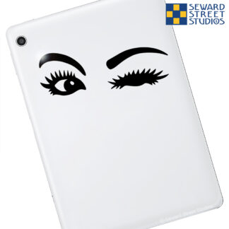 1198 Seward Street Studios Winking Eyes decal on a white tablet