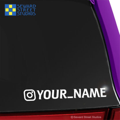 1227 Seward Street Studios instagram name decal shown on a pink car