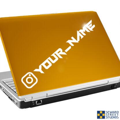 1227 Seward Street Studios instagram name decal shown on a gold laptop