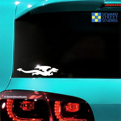 1188 Seward Street Studios Flying Dragon Decal shown on a blue car