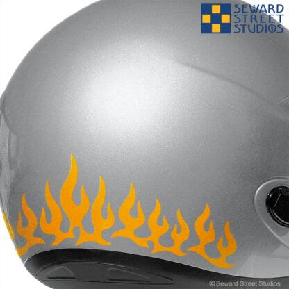 1207 Flames Decal Set by Seward Street Studios shown on a silver helmet.