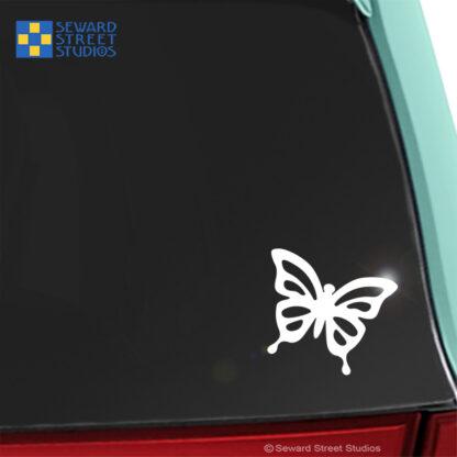 1234 Seward Street Studios Butterfly Decal shown on a teal car