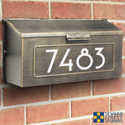 1246 Seward Street Studios Address Numbers Decal, shown in white vinyl, on a wall mounted mailbox