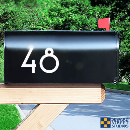 1250 Seward Street Studios Address Numbers Decal, shown in white vinyl, on a black mailbox