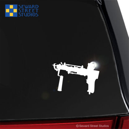 1271 Seward Street Studios Tufting Gun Decal shown on a black car