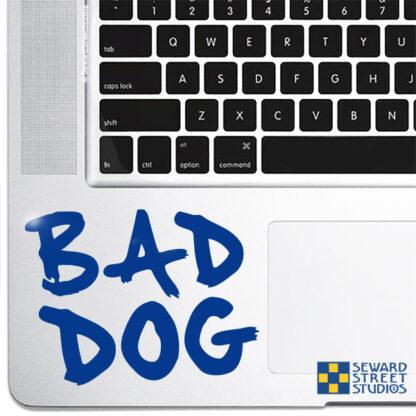 1118-Seward Street Studios bad dog vinyl decal on a laptop