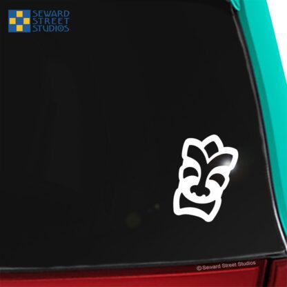 1291 Seward Street Studios Happy Tiki Head vinyl decal shown on a car window